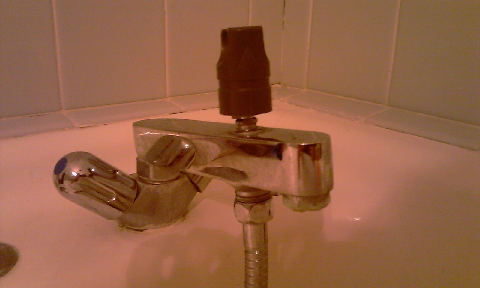 Demonter un ancien robinet melangeur bain-douche