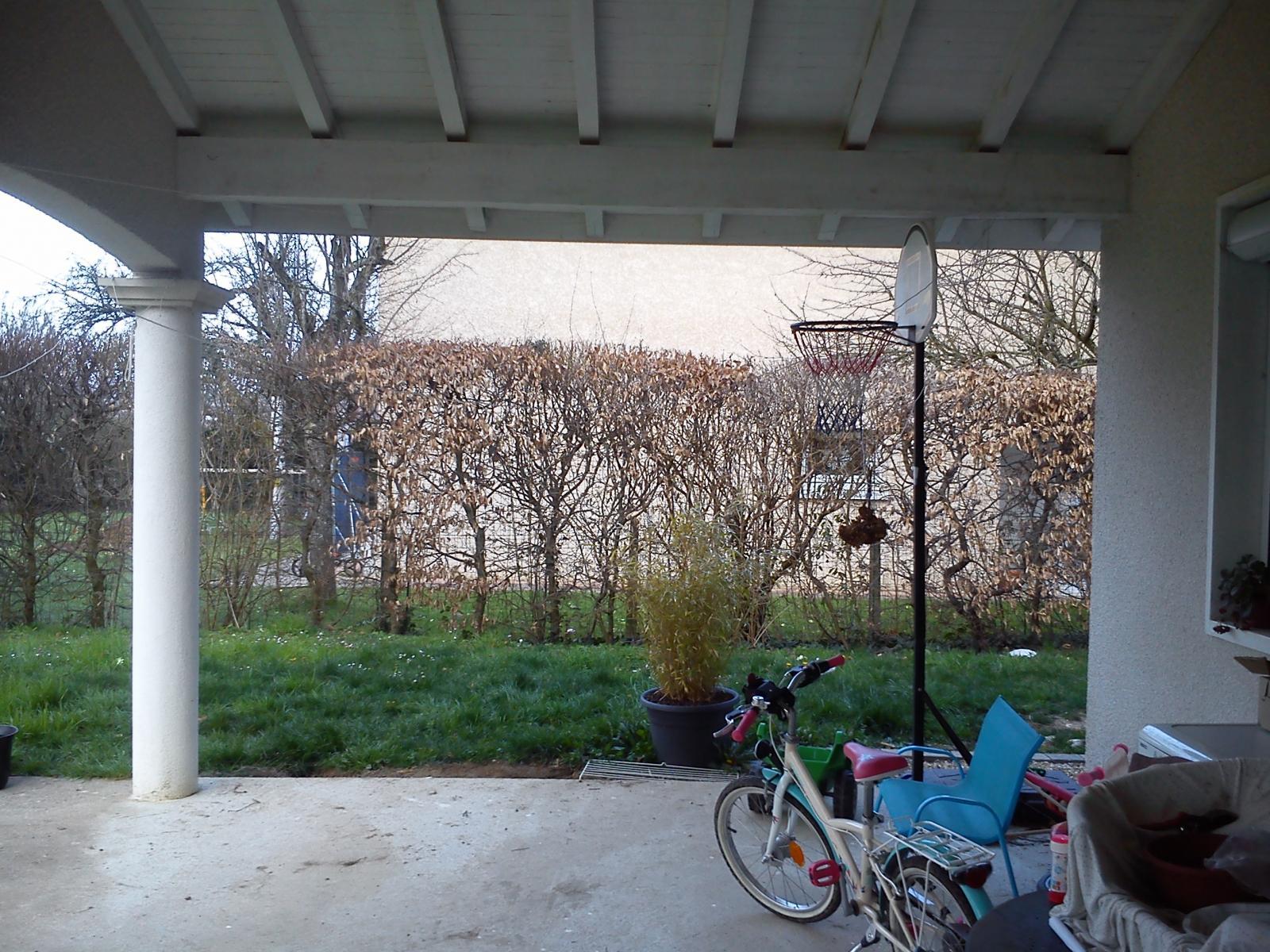 fermer un côté de terrasse couverte